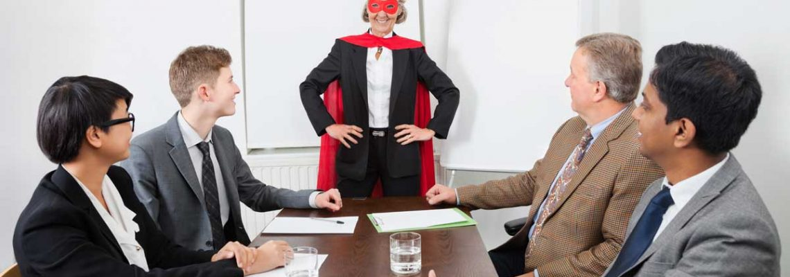 office team meeting with super costume