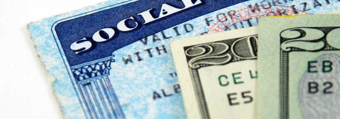 social security card and twenty dollar bills
