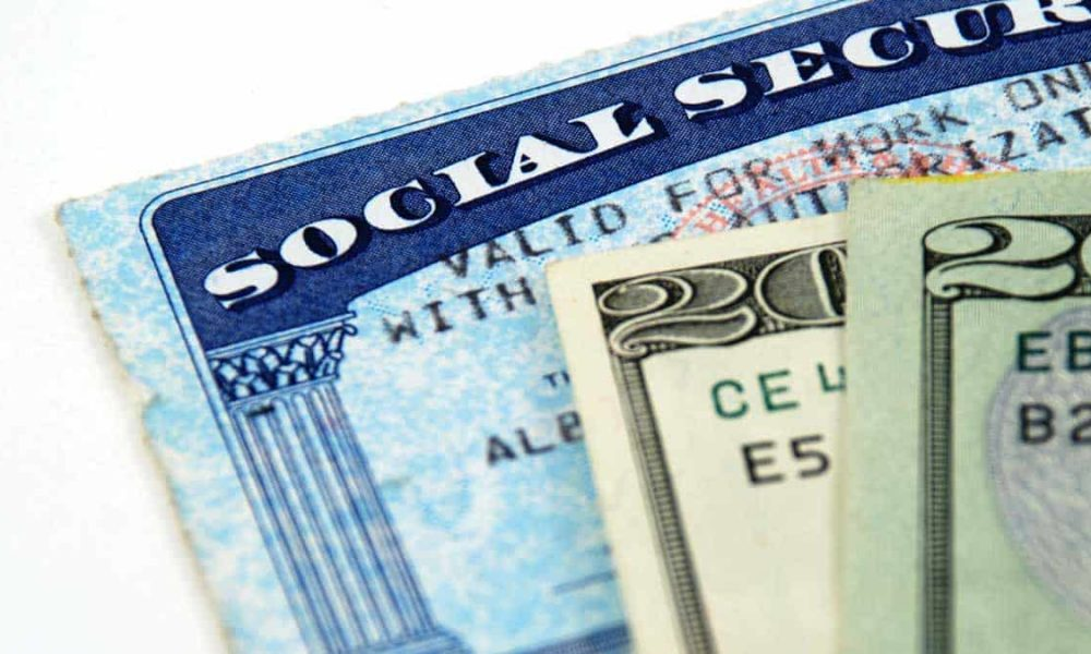 social security card and twenty dollar bills