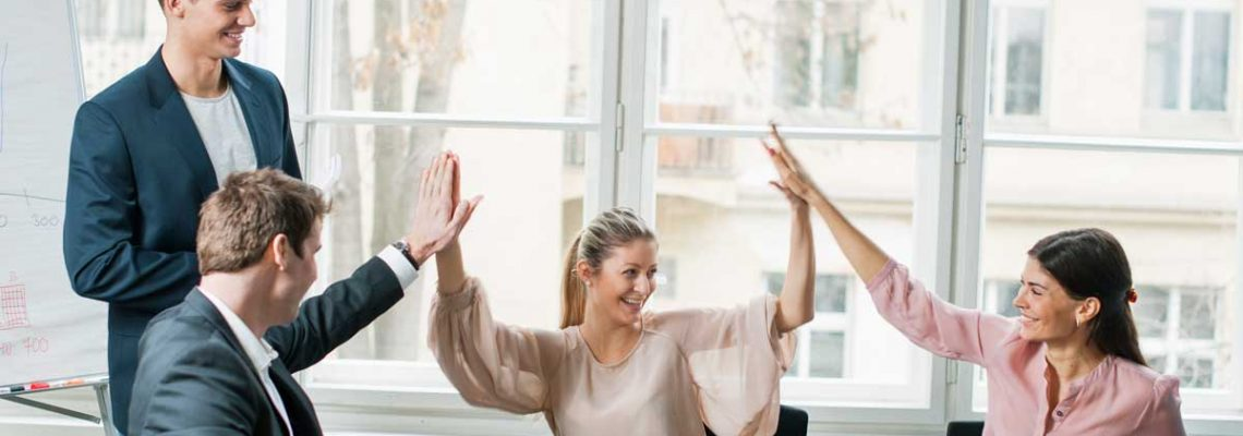 young-business-team-doing-high-five